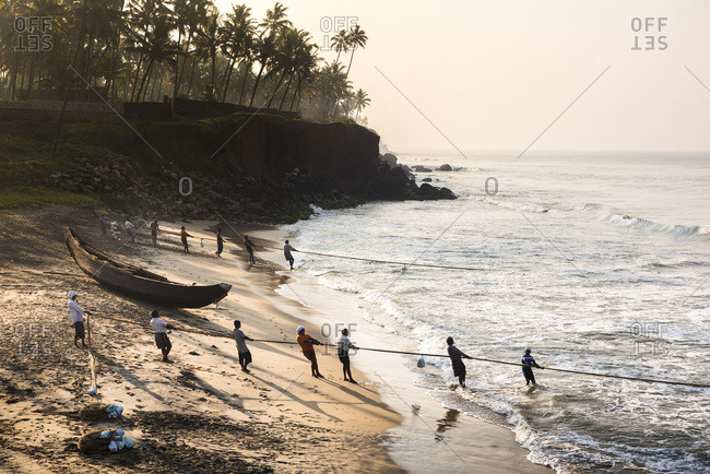 November 14, 2017: Fishermen at Kappil Beach, Varkala, Kerala, India, Asia