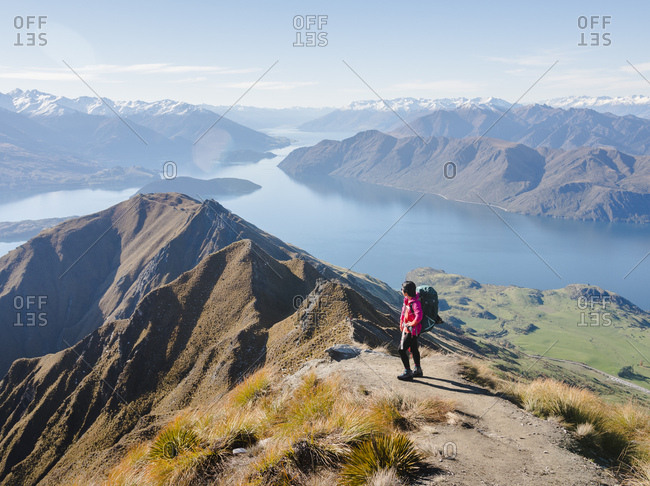 May 2, 2018: Woman hiker enjoying the view from the Roys Peak trail near Wanaka, Otago, South Island, New Zealand, Pacific