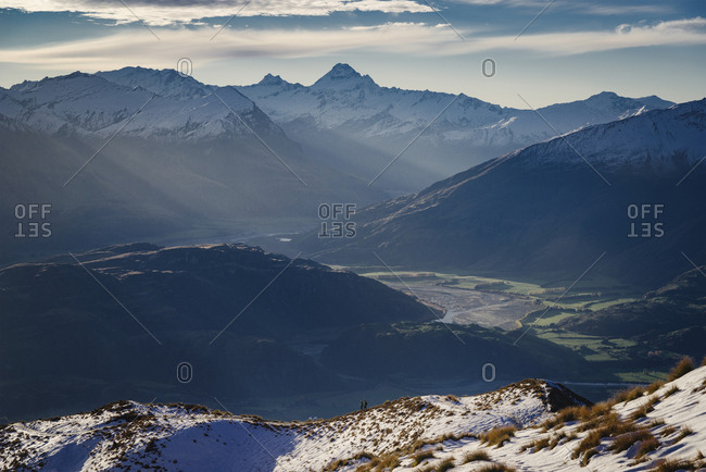 Hiking along the mountain ranges with a view of Mount Aspiring, Otago, South Island, New Zealand, Pacific