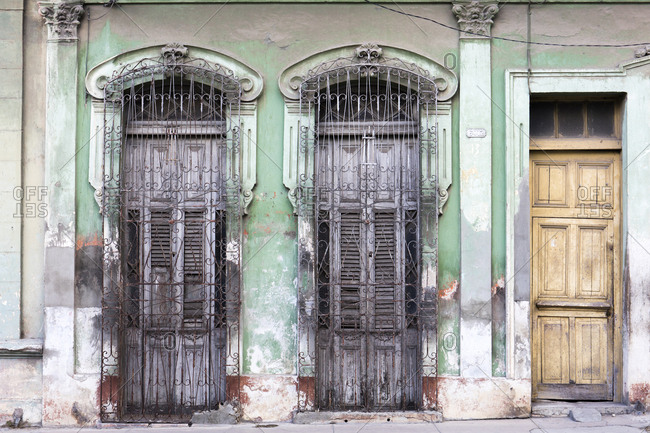 Old doorways and windows, covered by intricate metal gates, Cienfuegos, UNESCO World Heritage Site, Cuba, West Indies, Caribbean, Central America
