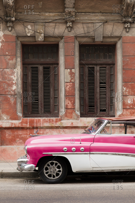 November 15, 2016: Front half of white and pink old vintage car, Havana, Cuba, West Indies, Caribbean, Central America