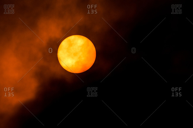 View of sun in smoky sky