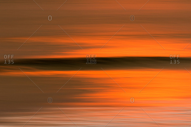 Abstract view of sunset reflected on water surface