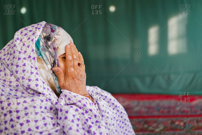 Muslim woman is praying