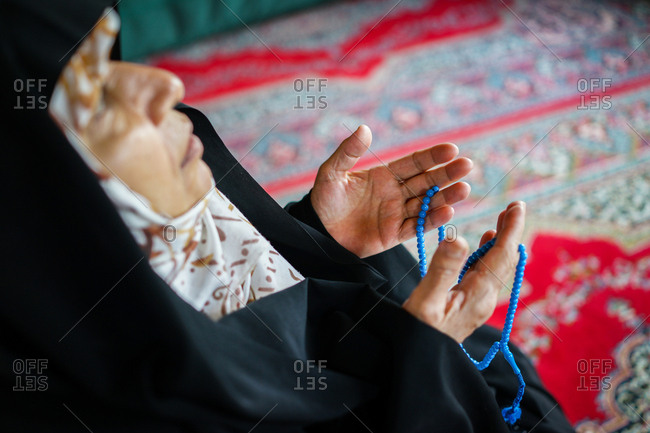 Muslim woman praying in a mosque