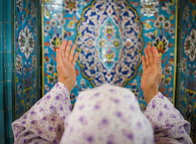 Muslim woman is praying in a beautiful mosque