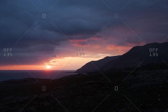 Light through the clouds over the Mediterranean sea on the south coast of Crete near Matala, Greece
