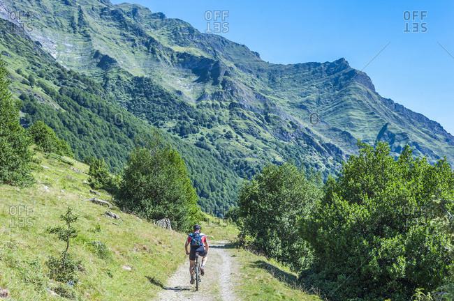 France, Pyrenees National Park, Occitanie region, Val d'Azun, Haute-vallee d'Estaing, cyclist, mountain bike on a track