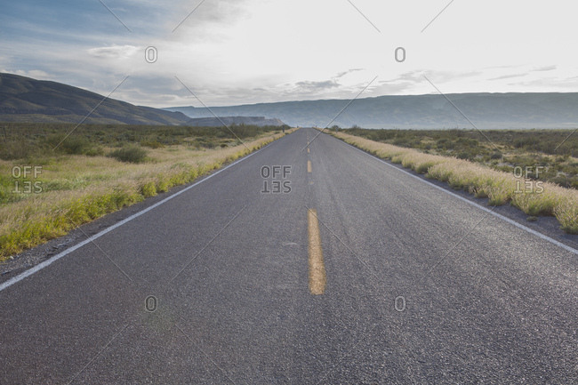 """Road in the middle of the Chihuanhuan Desert along the Cuatro Cienegas National Reserve called """"Parque Los Arenales"""" and where there are the white dunes of Yesos, Cuatro Cienegas, Coahuila State, Mexico"""