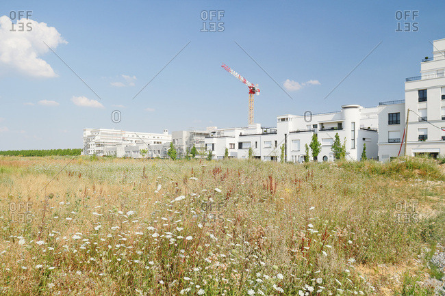 Seine et Marne. Serris. Montevrain. New city. Buildings under construction. Fileds.