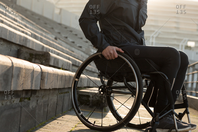 Low section of disabled athletic moving with wheelchair at sports venue