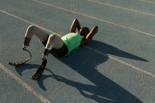 Tired disabled athletic relaxing on a running track