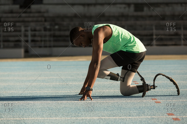 Disabled athletic getting ready for the race on a running track