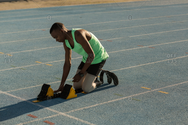 Disabled athletic preparing for the race on a running track