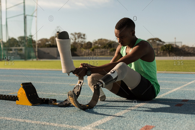 Disabled athletic wearing prosthetic leg on a running track