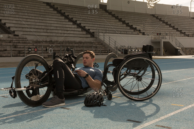 Male disabled athletic with wheelchair on a racing track