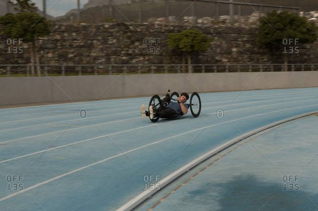 Disabled athlete racing in wheelchair on a racing track