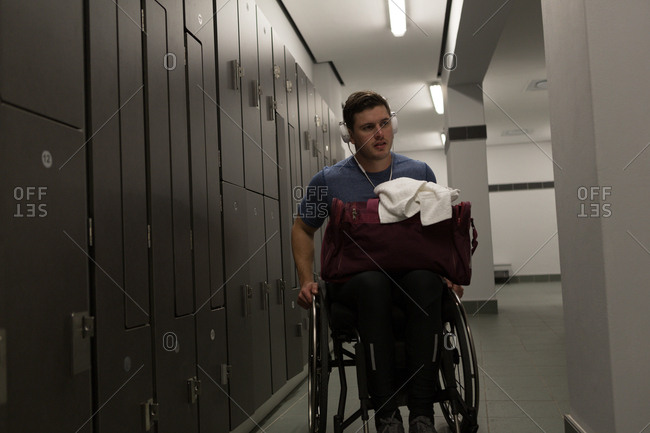 Smart disabled man with his bag in locker room
