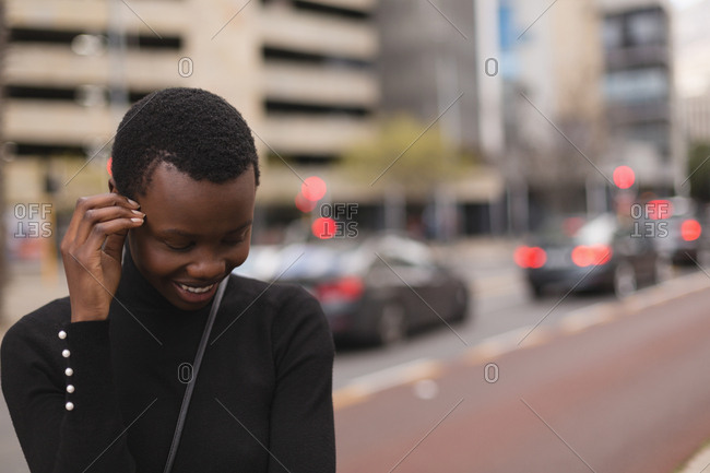 Happy woman standing in city street