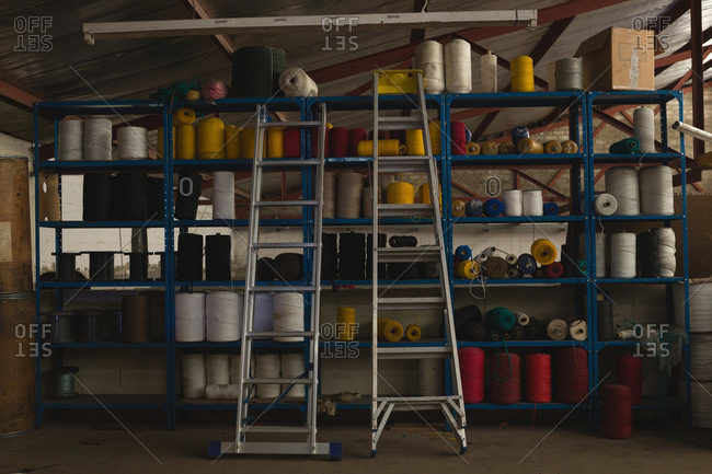 Rope roll arranged in pallet rack at rope making industry