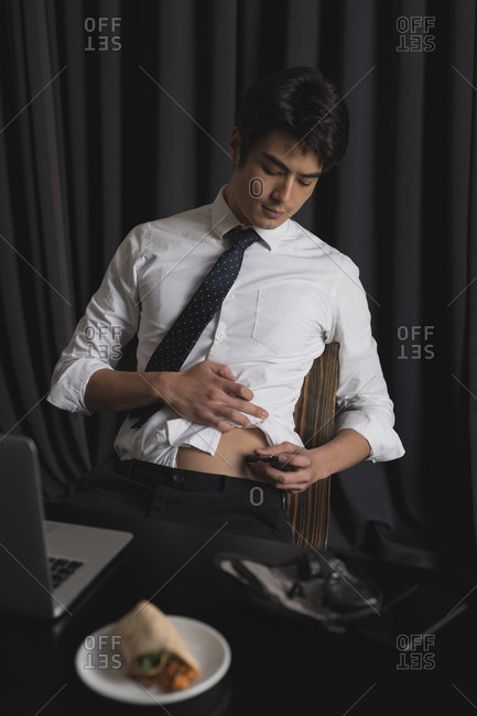 Smart business executive checking sugar level in office