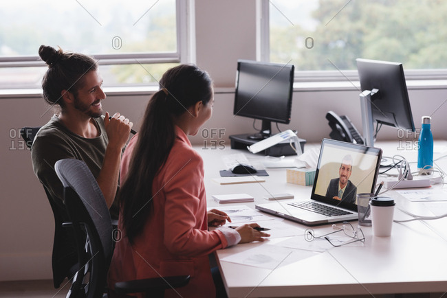Businessman and businesswoman having a video conference meeting in the office
