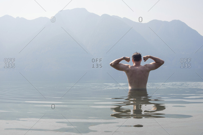 Man flexing while swimming in Desolation Sound, southern coastal British Columbia, Canada