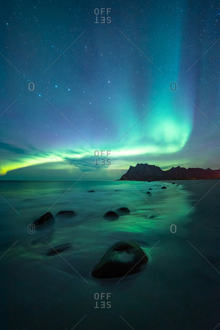 Northern lights over water in Norway