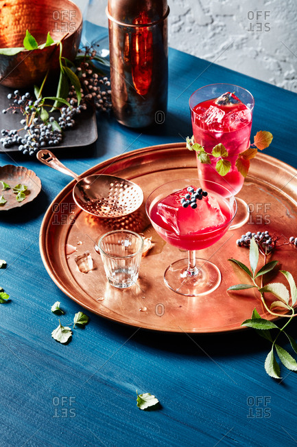 Bar scene with drinks on a copper tray