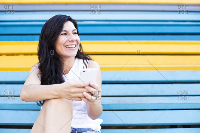 Woman smiling using her phone and looking away in Budapest, Hungary