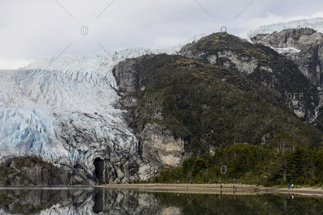 Scenic view of large coastal glacier along mountainside in Patagonia