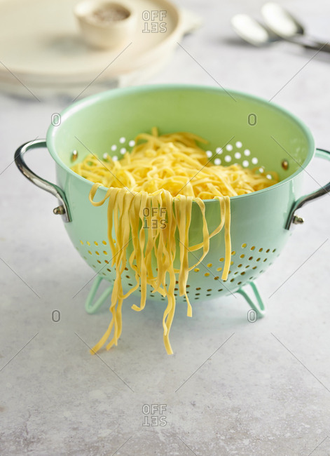 Cooked linguine pasta in a colander
