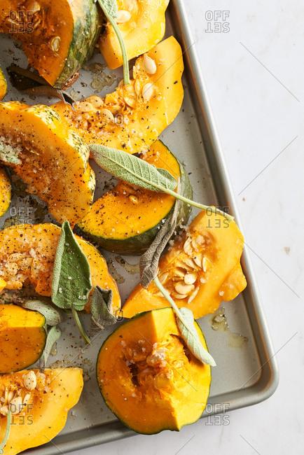 Pumpkin and sage on baking sheet