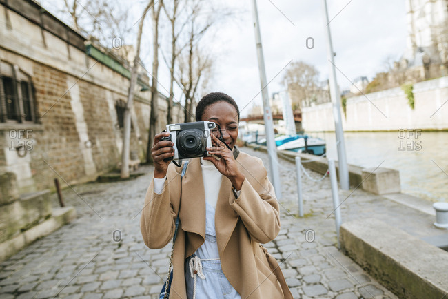 Woman with photo camera in Paris.