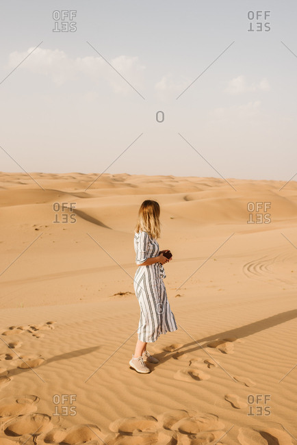 Blonde woman in desert in Dubai