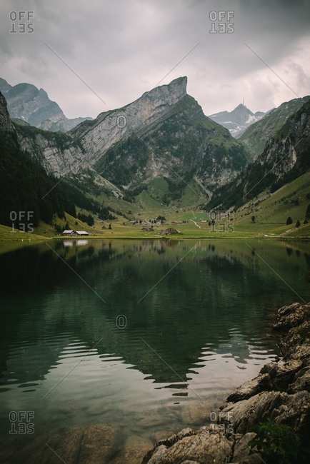 Mountain range reflecting in Seealpsee Lake in Switzerland