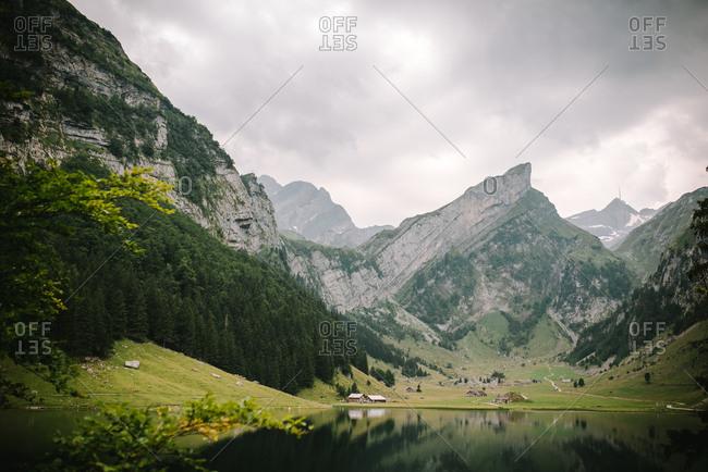 Mountain range beside Seealpsee Lake in Switzerland