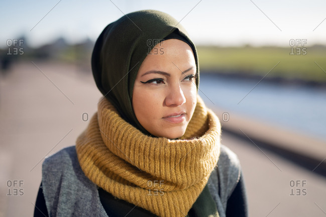 Portrait of a young woman wearing headscarf looking away