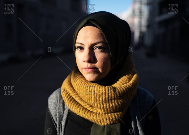 Portrait of a young woman wearing headscarf in the sunshine