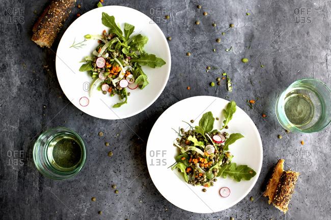 Green lentil arugula salad served with bread and drinks
