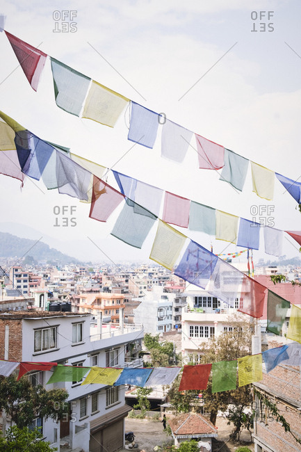 Prayer flags over buildings