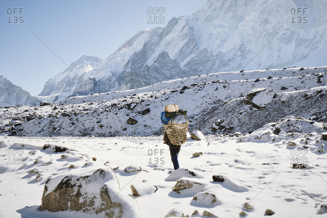 Person trekking through snow in the Himalayas