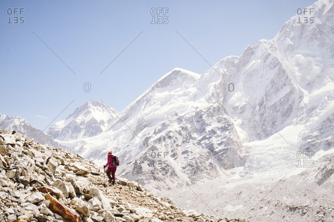 Person trekking through the Himalayan Mountains