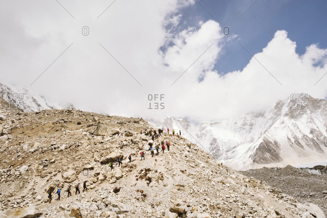 Group of hikers climbing mountain in Nepal