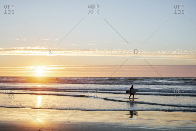 Big Sur, California - September 14, 2018: Surfer silhouette at sunset on Big Sur