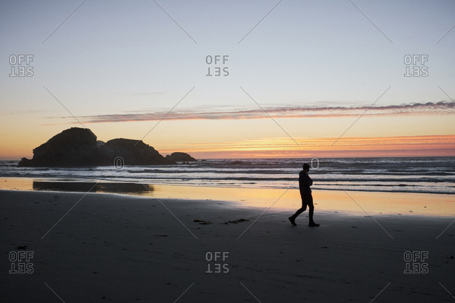 Man walking on Sand Dollar Beach, Big Sur, California