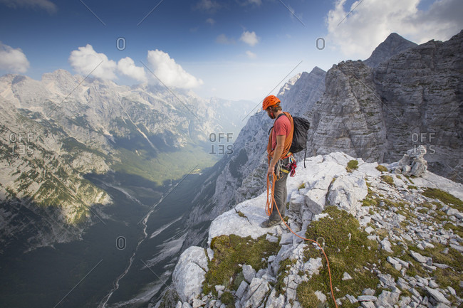 September 12, 2016: A mountain guide is overlooking the Vrata valley after climbing the famous north face of the Triglav, the highest peak in Slovenia