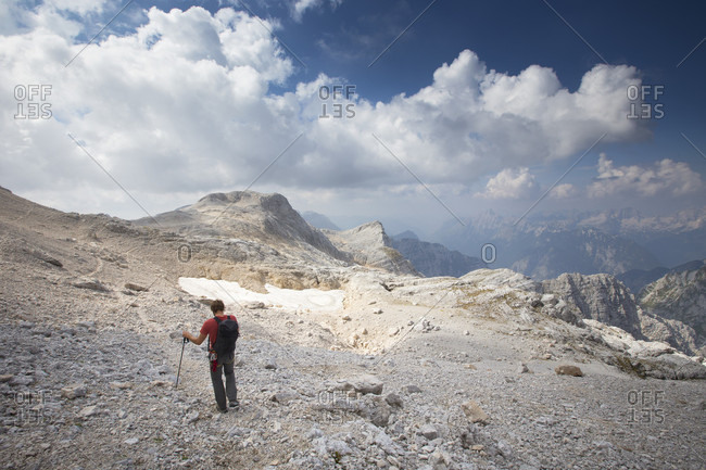September 12, 2016: A hiker walking in the moon like landscape of the summit plateau on Triglav, the highest mountain of Slovenia