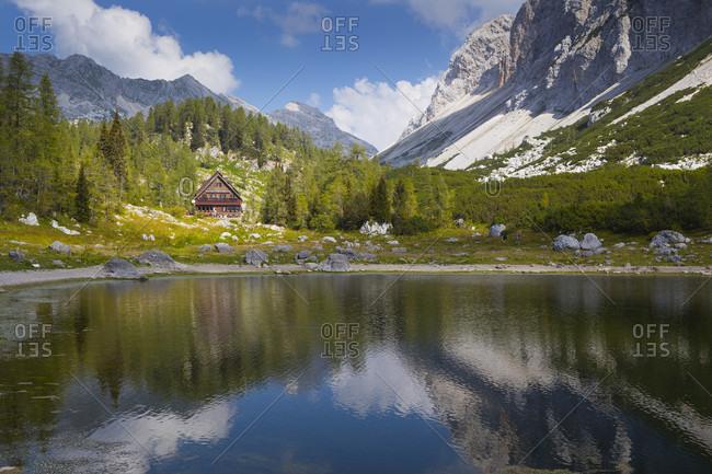September 13, 2016: View of mountain hut across lake in Dolina Sedmerih Jezer, Valley of the Seven lakes, Triglav National Park, Slovenia