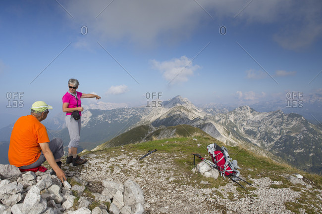 September 14, 2016: View of couple of elderly hikers at Mount Vogel, Triglav National Park, Slovenia